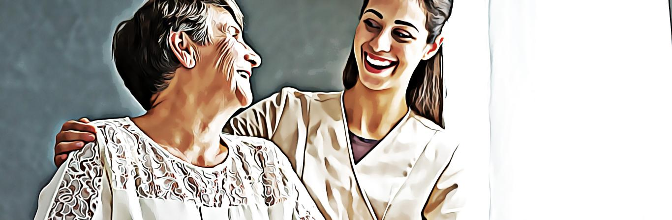 Elderly woman and healthcare provider smiling